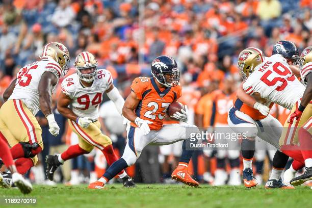 Running back Devontae Booker of the Denver Broncos rushes against the San Francisco 49ers during a preseason National Football League game at Broncos...