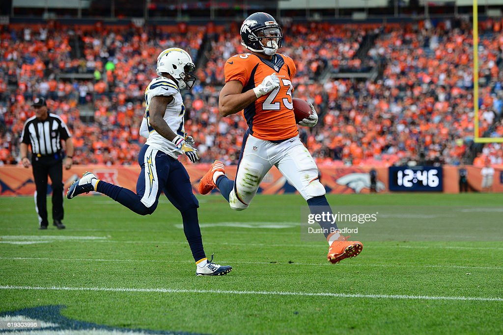Running back Devontae Booker #23 of the Denver Broncos rushes for a touchdown in the third quarter of the game against the San Diego Chargers at Sports Authority Field at Mile High on October 30, 2016 in Denver, Colorado.