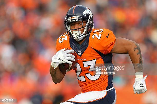Running back Devontae Booker of the Denver Broncos rushes for a touchdown in the first quarter of the game against the Oakland Raiders at Sports...