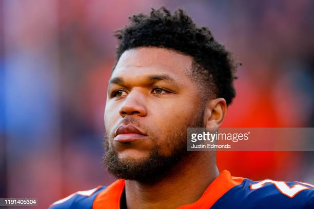 Running back Devontae Booker of the Denver Broncos stands on the field before a game against the Los Angeles Chargers at Empower Field at Mile High...