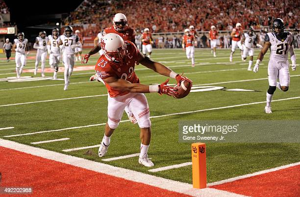 Running back Devontae Booker of the Utah Utes scores a first quarter touchdown against the California Golden Bears at Rice-Eccles Stadium on October...