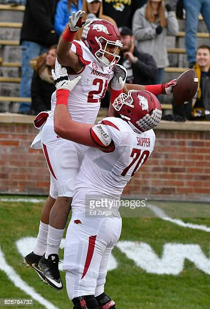 Running back Devwah Whaley of the Arkansas Razorbacks celebrates his touchdown with Dan Skipper against the Missouri Tigers in the first quarter at...