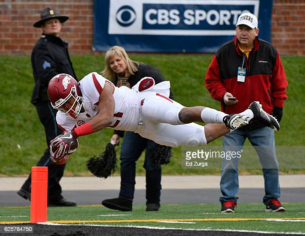 Running back Devwah Whaley of the Arkansas Razorbacks dives into the end zone for a touchdown against the Missouri Tigers in the first quarter at...
