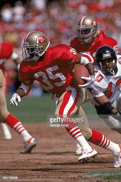 Running back Dexter Carter of the San Francisco 49ers rushes for yards past defensive back Brian Jordan 40 of the Atlanta Falcons at Candlestick Park...