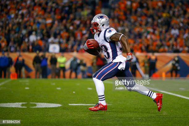 Running back Dion Lewis of the New England Patriots returns a kickoff for a first quarter touchdown against the Denver Broncos at Sports Authority...