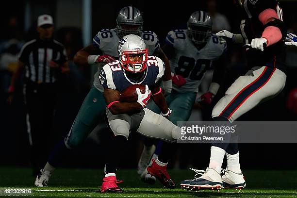 Running back Dion Lewis of the New England Patriots rushes the football against the Dallas Cowboys during the second half of the NFL game at ATT...