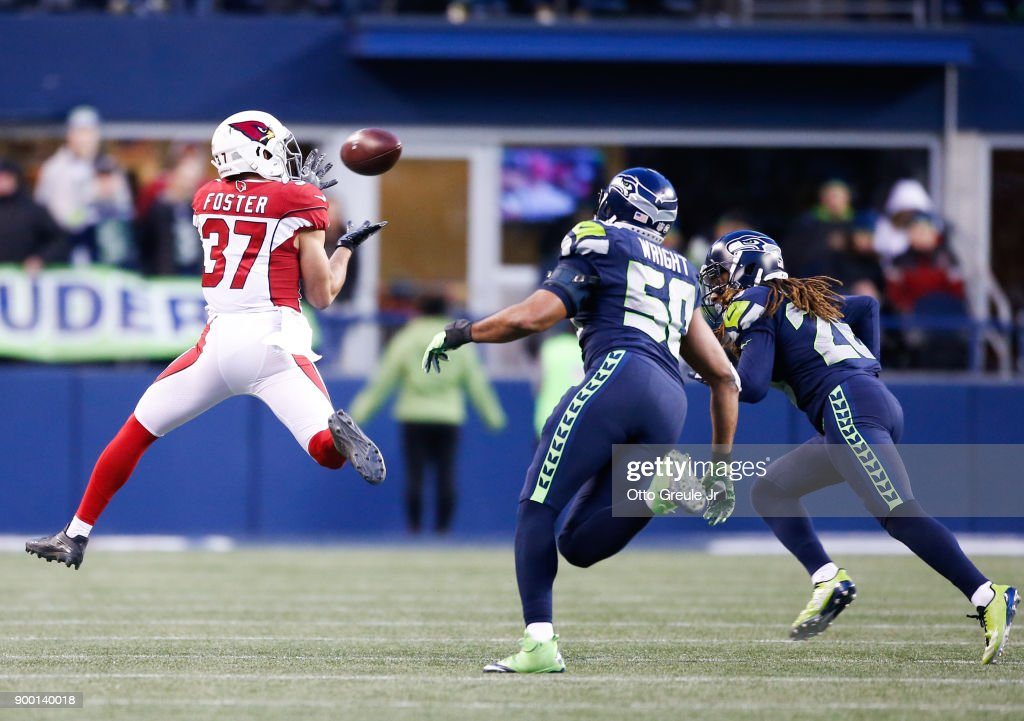 Running back D.J. Foster #37 of the Arizona Cardinals makes a first-down reception against linebacker K.J. Wright #50 of the Seattle Seahawks in the second half at CenturyLink Field on December 31, 2017 in Seattle, Washington.