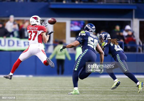 Running back DJ Foster of the Arizona Cardinals makes a firstdown reception against linebacker KJ Wright of the Seattle Seahawks in the second half...