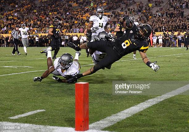 Running back DJ Foster of the Arizona State Sun Devils dives into the end zone to score a 23 yard rushing touchdown against the Oregon Ducks during...