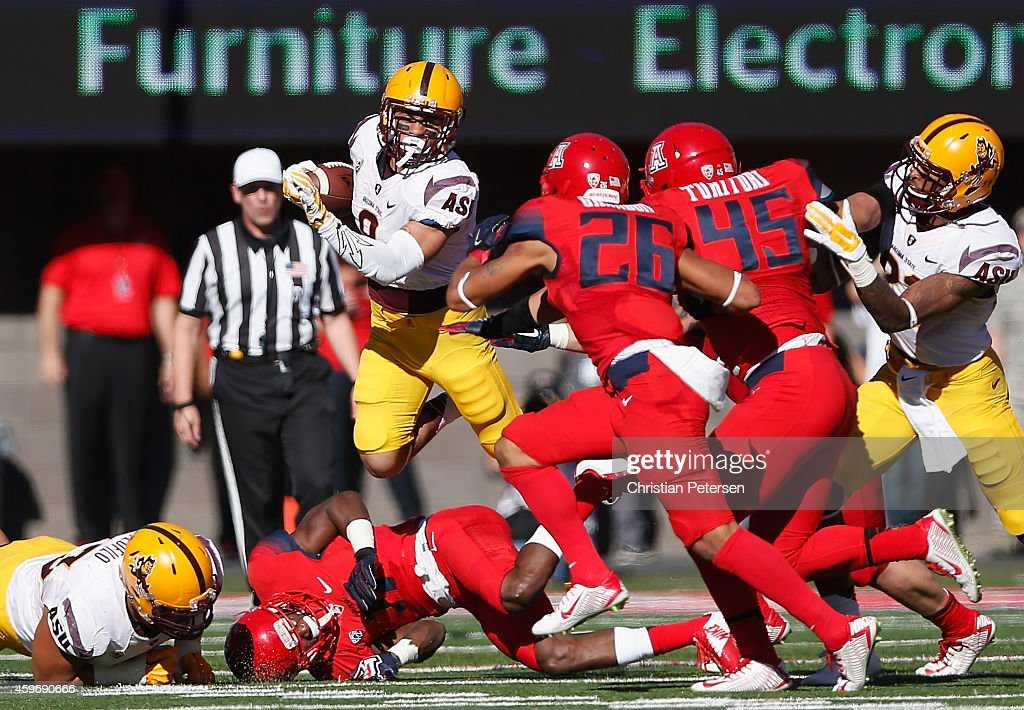Running back D.J. Foster #8 of the Arizona State Sun Devils rushes the football against the Arizona Wildcats in the first quarter of the Territorial Cup college football game at Arizona Stadium on November 28, 2014 in Tucson, Arizona.