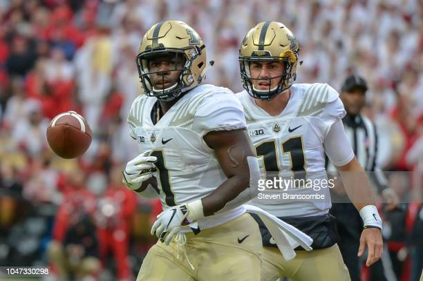 Running back DJ Knox of the Purdue Boilermakers and quarterback David Blough celebrate a score at Memorial Stadium on September 29 2018 in Lincoln...