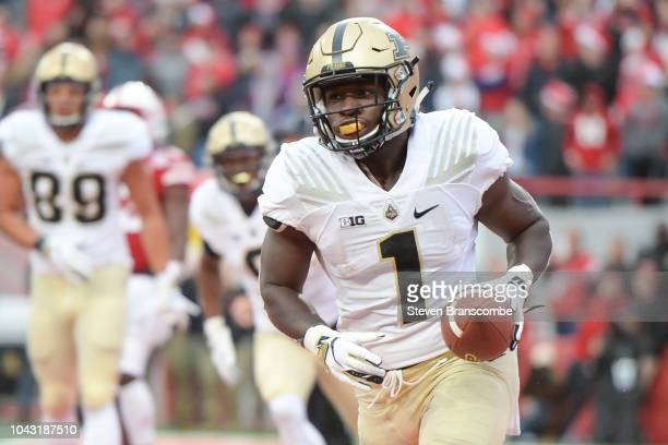 Running back DJ Knox of the Purdue Boilermakers celebrates a score against the Nebraska Cornhuskers at Memorial Stadium on September 29 2018 in...