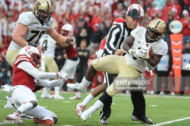 Running back DJ Knox of the Purdue Boilermakers escapes the grip of defensive back Deontai Williams of the Nebraska Cornhuskers to score in the...