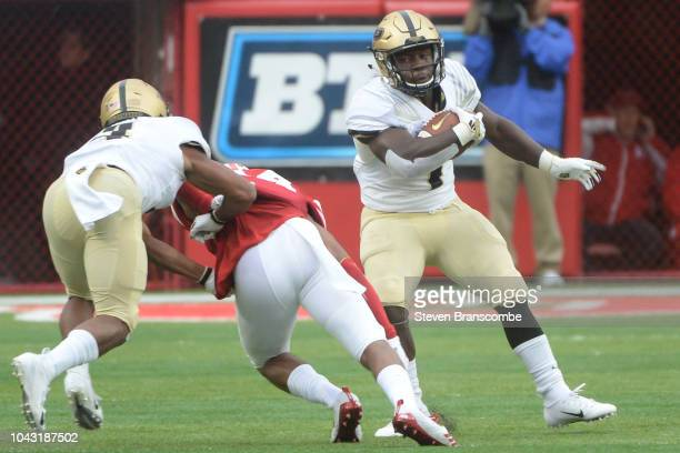Running back DJ Knox of the Purdue Boilermakers runs around a tackle in the second half against the Nebraska Cornhuskers at Memorial Stadium on...