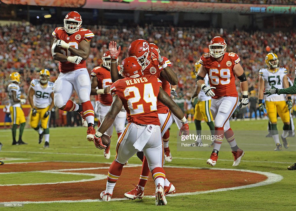 Running back D.J. White #24 of the Kansas City Chiefs celebrates with his teammates after scoring a touchdown against the Green Bay Packers during the first half on September 1, 2016 at Arrowhead Stadium in Kansas City, Missouri.