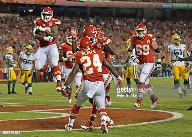 Running back D.J. White of the Kansas City Chiefs celebrates with his teammates after scoring a touchdown against the Green Bay Packers during the...