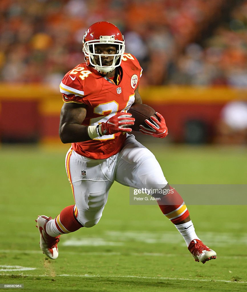 Running back D.J. White #24 of the Kansas City Chiefs rushes up field against the Green Bay Packers during the first half on September 1, 2016 at Arrowhead Stadium in Kansas City, Missouri.