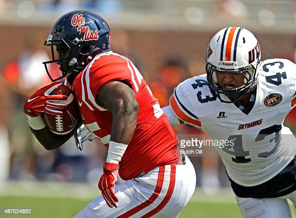 Running back DK Buford of the Mississippi Rebels gets past linebacker James Cotton of the Tennessee Martin Skyhawks for a touchdown during the second...
