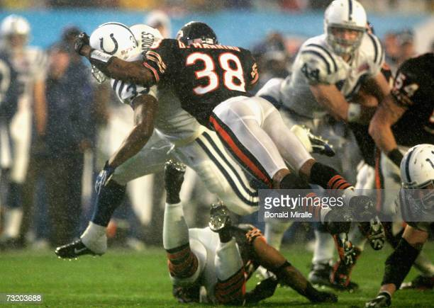 Running back Dominic Rhodes of the Indianapolis Colts is brought down by safety Danieal Manning of the Chicago Bears after a 36yard carry in the...