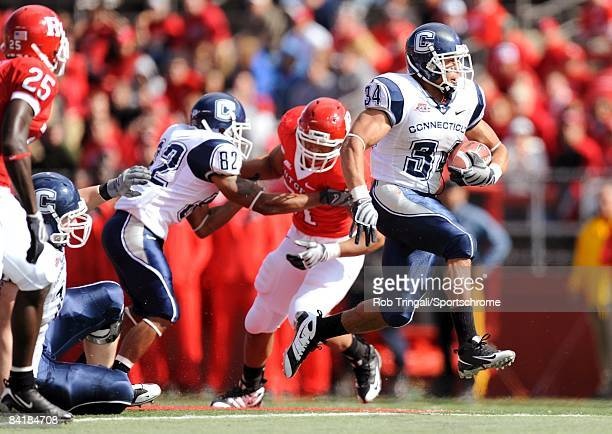 Running back Donald Brown of the Connecticut Huskies rushes against the Rutgers Scarlet Knights at Rutgers Stadium on October 18, 2008 in Piscataway,...