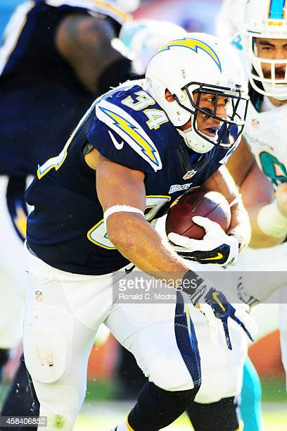 Running back Donald Brown of the San Diego Chargers carries the ball during a NFL game against the Miami Dolphins at Sun Life Stadium on November 2...