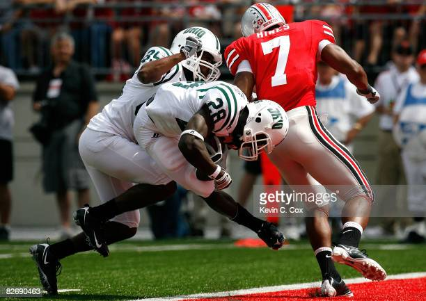 Running back Donte Harden of the Ohio Bobcats scores a touchdown against linebacker Jermale Hines of the Ohio State Buckeyes during the game at Ohio...