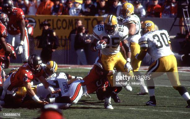 Running Back Dorsey Levens of the Green Bay Packers runs for a few extra yards before being tackled by Safety Charles Mincy of the Tampa Bay...