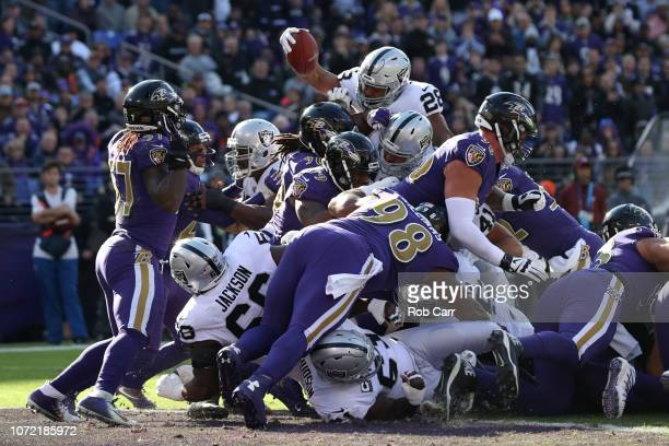 Running Back Doug Martin of the Oakland Raiders leaps for a touchdown in the first quarter against the Baltimore Ravens at MT Bank Stadium on...