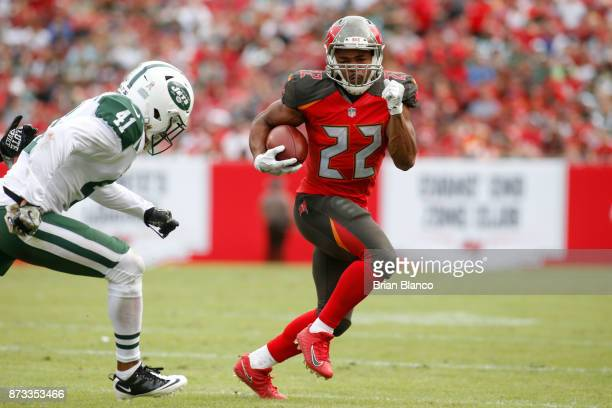 Running back Doug Martin of the Tampa Bay Buccaneers avoids cornerback Buster Skrine of the New York Jets during a carry in the third quarter of an...