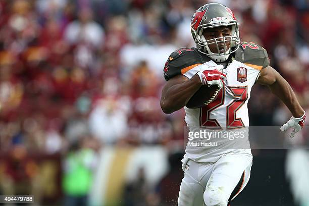 Running back Doug Martin of the Tampa Bay Buccaneers carries the ball in the fourth quarter of a game against the Washington Redskins at FedExField...