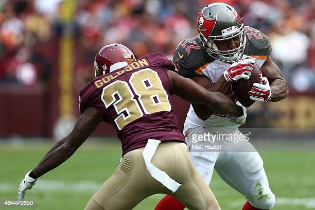 Running back Doug Martin of the Tampa Bay Buccaneers carries the ball while free safety Dashon Goldson of the Washington Redskins defends in the...