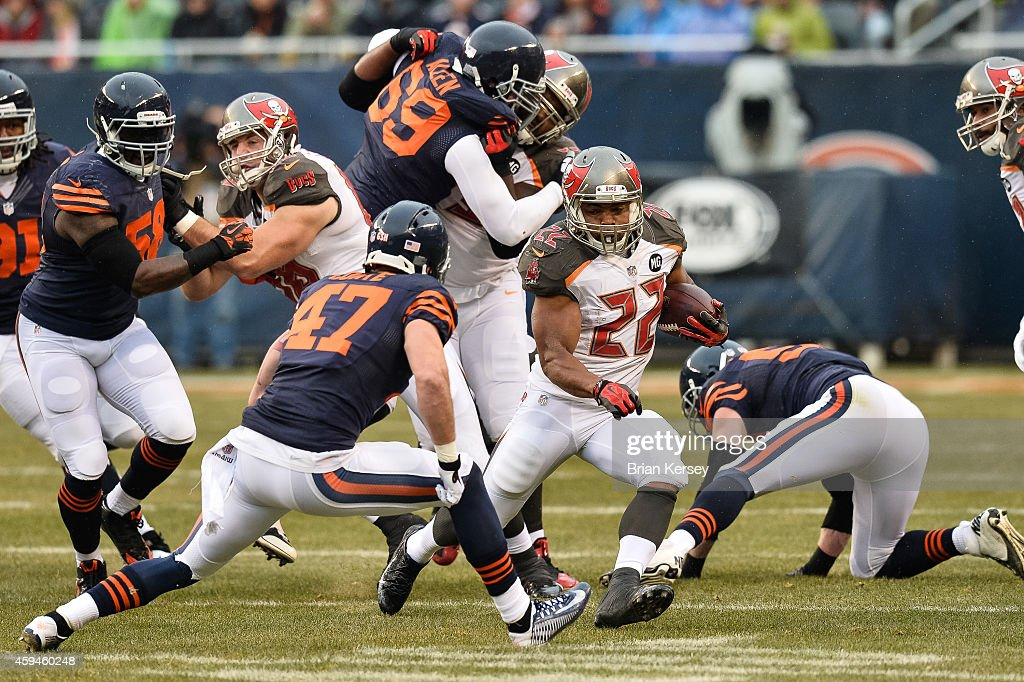 Running back Doug Martin #22 of the Tampa Bay Buccaneers carries the football against free safety Chris Conte #47 of the Chicago Bears in the first quarter at Soldier Field on November 23, 2014 in Chicago, Illinois.