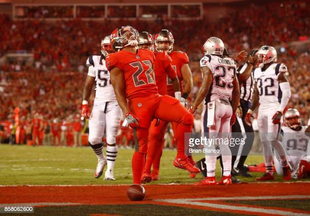 Running back Doug Martin of the Tampa Bay Buccaneers celebrates in the end zone following a 1-yard rush for a touchdown during the second quarter of...