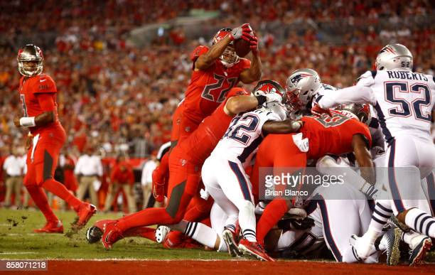Running back Doug Martin of the Tampa Bay Buccaneers goes over the top on a oneyard rush for a touchdown during the second quarter of an NFL football...