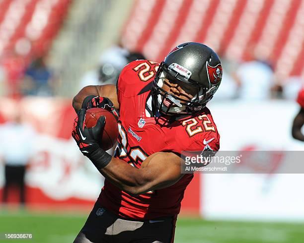 Running back Doug Martin of the Tampa Bay Buccaneers grabs a warmup pass against the Atlanta Falcons November 25 2012 at Raymond James Stadium in...