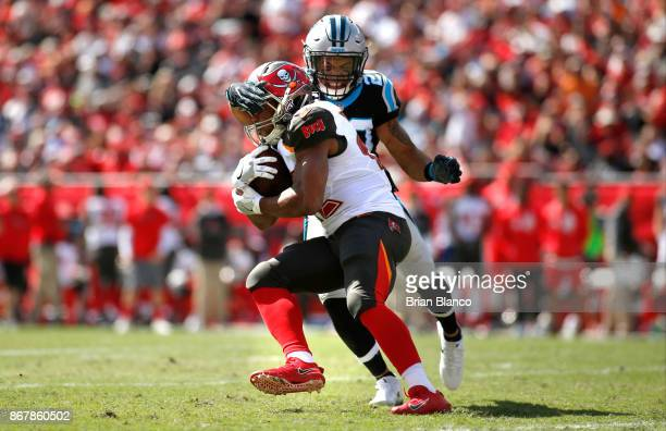 Running back Doug Martin of the Tampa Bay Buccaneers is stopped by free safety Kurt Coleman of the Carolina Panthers as he runs for a first down...