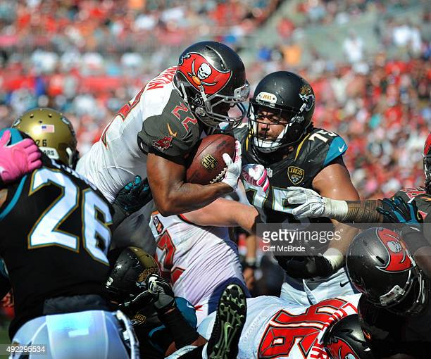 Running back Doug Martin of the Tampa Bay Buccaneers jumps over the top for a touchdown against the Jacksonville Jaguars in the fourth quarter at...