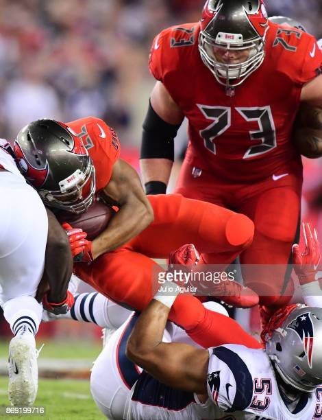 Running back Doug Martin of the Tampa Bay Buccaneers looks for yardage against the New England Patriots on October 5 2017 at Raymond James Stadium in...