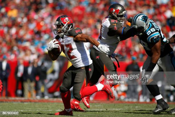 Running back Doug Martin of the Tampa Bay Buccaneers makes 14yard gain during the third quarter of an NFL football game against the Carolina Panthers...