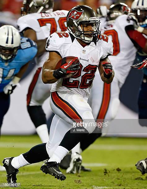 Running back Doug Martin of the Tampa Bay Buccaneers runs the ball against the Tennessee Titans during a preseason game at Raymond James Stadium on...