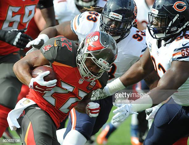 Running back Doug Martin of the Tampa Bay Buccaneers runs with the ball against the Chicago Bears in the first quarter at Raymond James Stadium on...