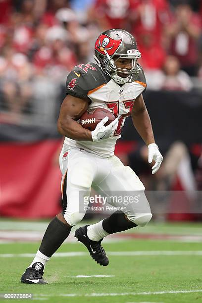 Running back Doug Martin of the Tampa Bay Buccaneers runs with the football during the NFL game against the Arizona Cardinals at the University of...