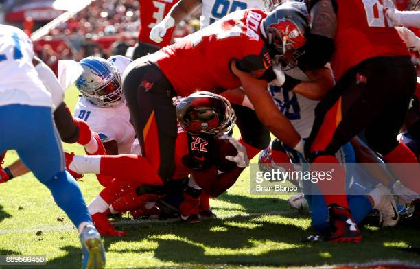 Running back Doug Martin of the Tampa Bay Buccaneers rushes for a 1yard touchdown during the first quarter of an NFL football game against the...