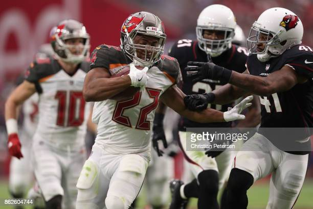 Running back Doug Martin of the Tampa Bay Buccaneers rushes the football past strong safety Antoine Bethea of the Arizona Cardinals during the second...