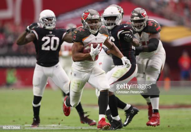 Running back Doug Martin of the Tampa Bay Buccaneers rushes the football against the Arizona Cardinals during the second half of the NFL game at the...