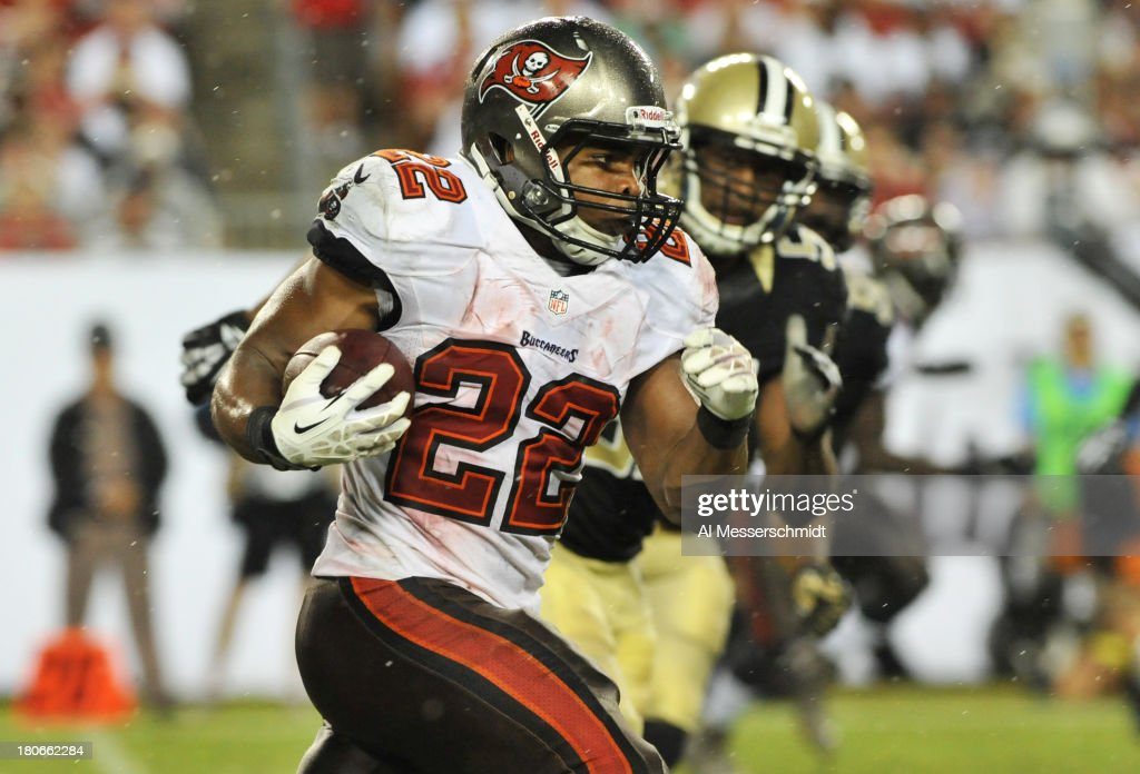 Running back Doug Martin #22 of the Tampa Bay Buccaneers rushes upfield in the 4th quarter against the New Orleans Saints September 15, 2013 at Raymond James Stadium in Tampa, Florida. The Saints won 16 - 14.