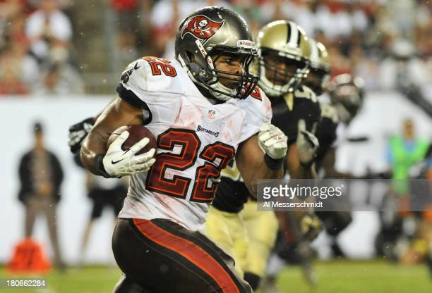 Running back Doug Martin of the Tampa Bay Buccaneers rushes upfield in the 4th quarter against the New Orleans Saints September 15 2013 at Raymond...