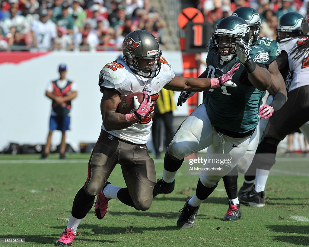 Running back Doug Martin #22 of the Tampa Bay Buccaneers rushes upfield against the Philadelphia Eagles October 13, 2013 at Raymond James Stadium in Tampa, Florida.