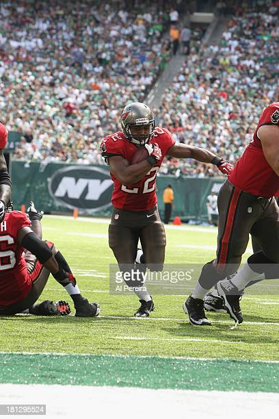 Running Back Doug Martin of the Tampa Bay Buccaneers scores a Touchdown against the New York Jets at MetLife Stadium on September 8 2013 in East...