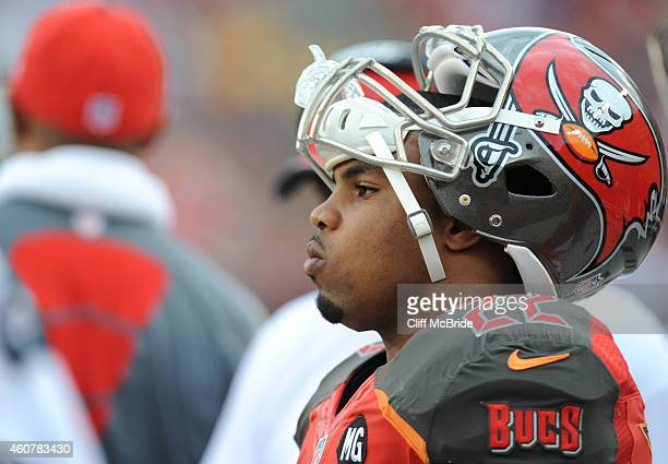 Running back Doug Martin of the Tampa Bay Buccaneers watches from the sidelines against the Green Bay Packers at Raymond James Stadium on December 21...